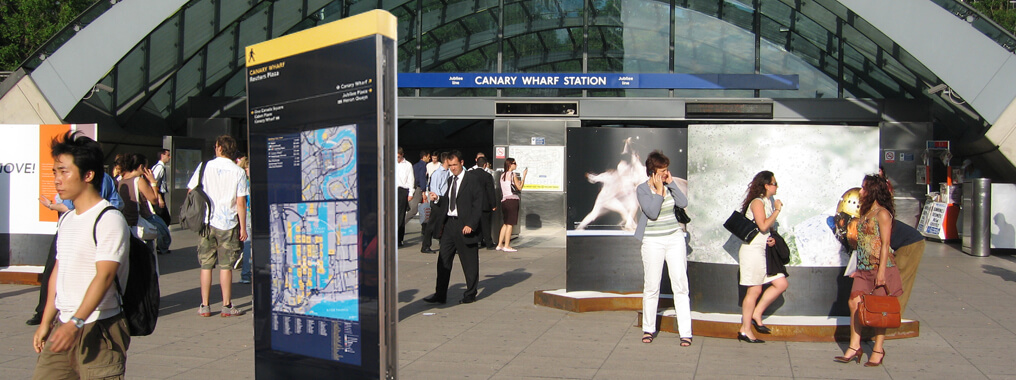 Outdoor digital wayfinding totem outside of the Canary Wharf Station in London.